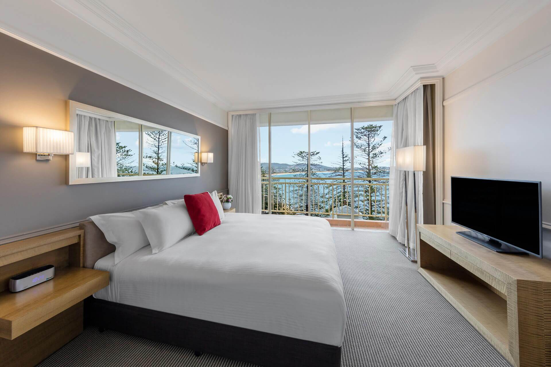 double bed in hotel room with ocean view