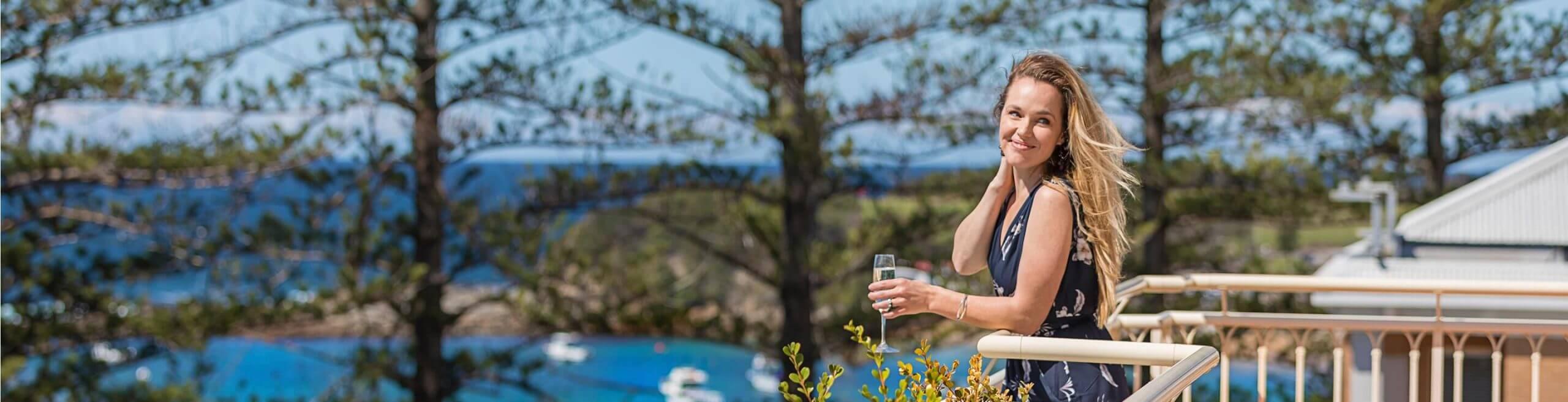 woman posing on balcony